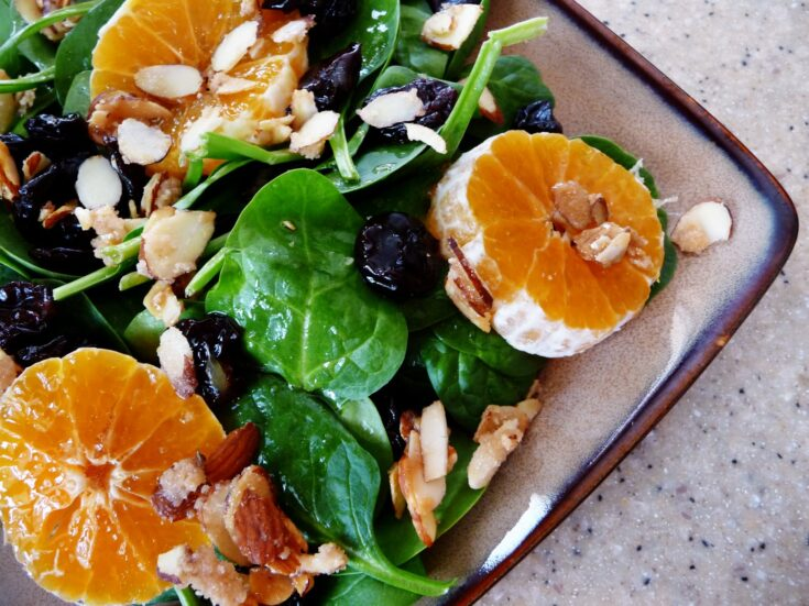 Spinach and Clementine Salad with Vanilla Sugar Almonds | Salads are so much fun to dress up. Making a quick dressing and coating some almonds really makes a pretty plate.