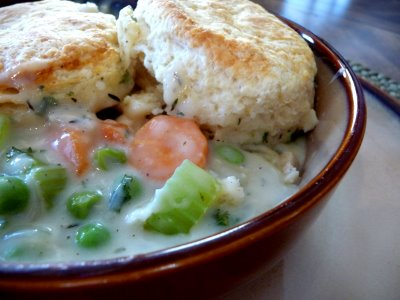 Creamy chicken filling is topped with tender buttermilk biscuits. Chicken Pot Pie with Buttermilk Biscuits is comfort food and it's finest!