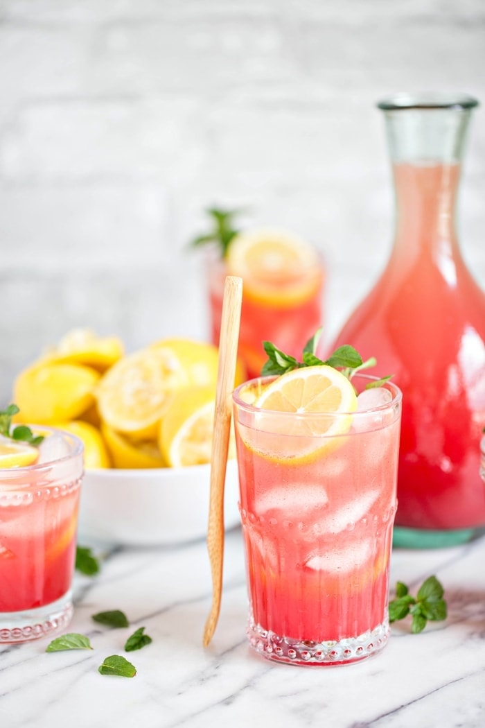 Homemade Watermelon Mint Lemonade is a fun take on the traditional homemade lemonade recipe – and it couldn't be more summery with it's gorgeous bright pink color.  The perfect fruity and refreshing drink for the whole family on a hot day!