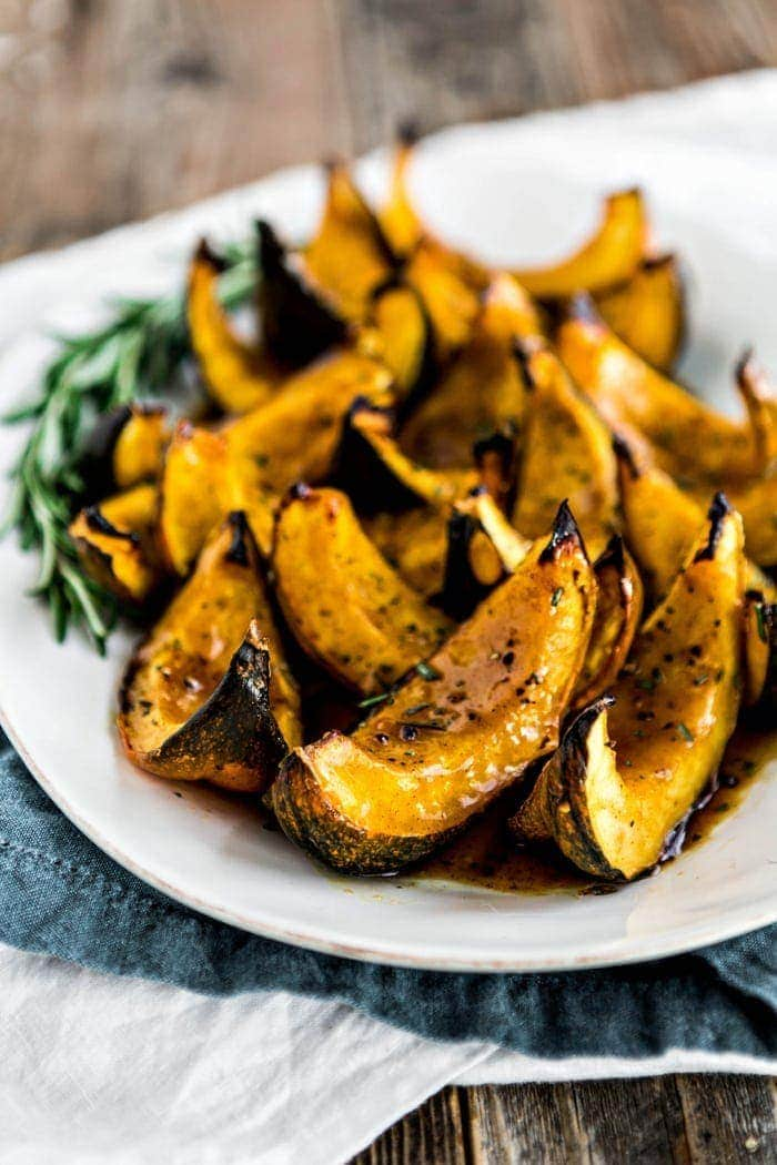 This Apple Cider Roasted Squash is a great, easy acorn squash side dish to prepare all winter long - but it is especially great for Thanksgiving