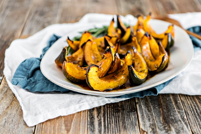 apple cider roasted squash on white platter