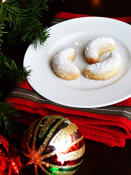 swedish cookies dusted with powdered sugar on white plate