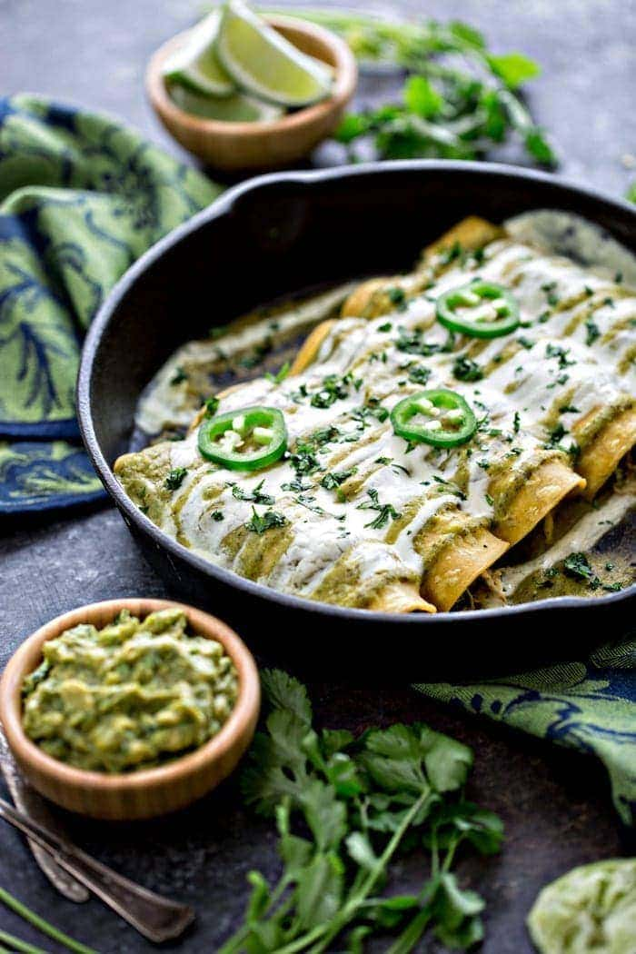 Chicken, Black Bean, and Spinach Enchiladas with Tomatillo Enchilada Sauce - Corn tortillas are filled with tender, shredded chicken, black beans, and fresh spinach. Then, smothered in two contrasting sauces for one amazing Chicken Enchilada recipe.