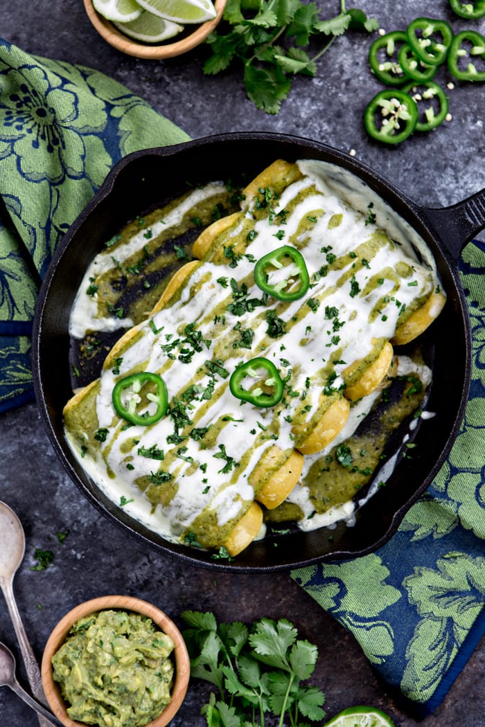 sour cream chicken enchiladas in cast iron skillet