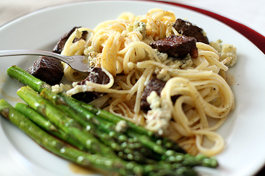 gorgonzola cream sauce pasta with asparagus on a white plate