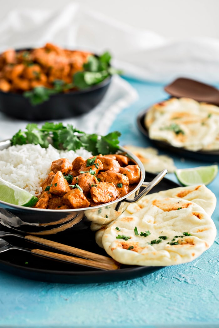 Indian Butter Chicken with Basmati Rice is a delicious, easy Indian recipe.  This family favorite makes it simple to cook popular Indian recipes at home.  It features tender chicken in an Indian spiced creamy, tomato based sauce featuring the flavors of garam masala.
