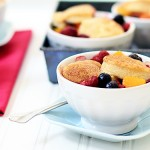 raspberry, blueberry, and peach cobbler with biscuit crust