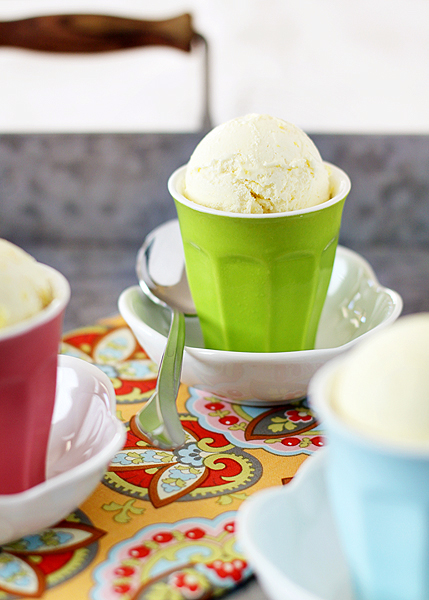 lemon ice cream in green cup with spoon