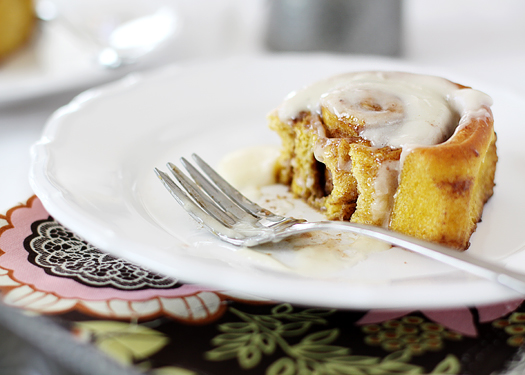 Pumpkin Cinnamon Rolls are the perfect fall treat - pumpkin spice dough is rolled with plenty of cinnamon and sugar, and then slathered in cream cheese frosting.