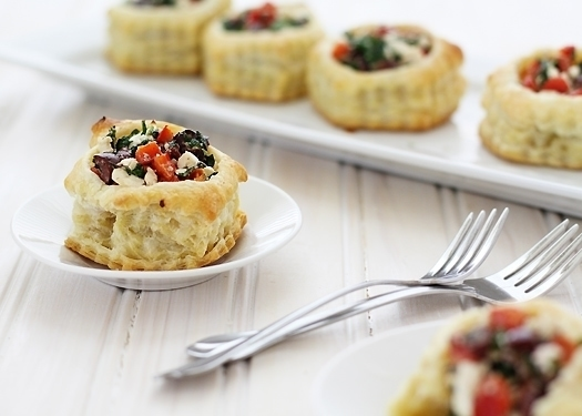 Puff Pastry Appetizer with Kalamata Olives - Greek Puff Pastry Appetizer - Puff pastry shells are baked and filled with a mixture of kalamata olives, red bell pepper, fresh oregano, feta, and spinach with a warm lemony olive oil vinaigrette for a scrumptious puff pastry appetizer perfect for any holiday party.
