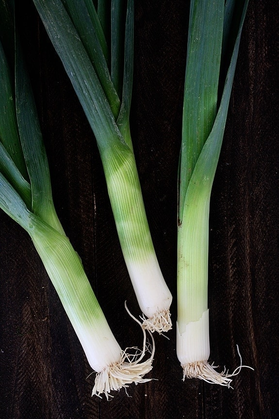 Leeks are tasty but you need to learn how to clean them properly because they can be rather dirty since they grow in sandy soil. Learn all about: what do leeks taste like, what are leeks, how to clean leeks, and recipes that use leeks!