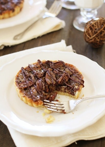 Chocolate Pecan Tarts are a unique way to serve your pecan pie this Thanksgiving.