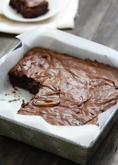 easy homemade brownies in baking pan lined with parchment paper