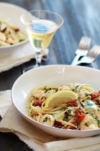 This recipe for Shrimp Scampi with Tomatoes and Artichokes is the perfect easy, yet romantic, pasta dinner for Valentine's Day.