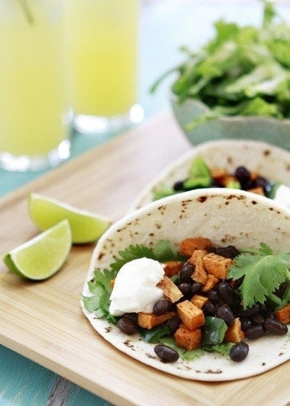 These Roasted Sweet Potato and Black Bean Tacos are a quick and easy vegetarian option for any Taco Tuesday Night or Cinco de Mayo Menu!
