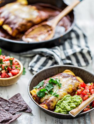 Chicken Enchiladas with Homemade Chile Gravy Enchilada Sauce is a classic Tex-Mex dish from my childhood. Corn tortillas are stuffed with shredded chicken and smothered in a rich, chili gravy sauce before baked up to perfection with a gooey cheese topping.