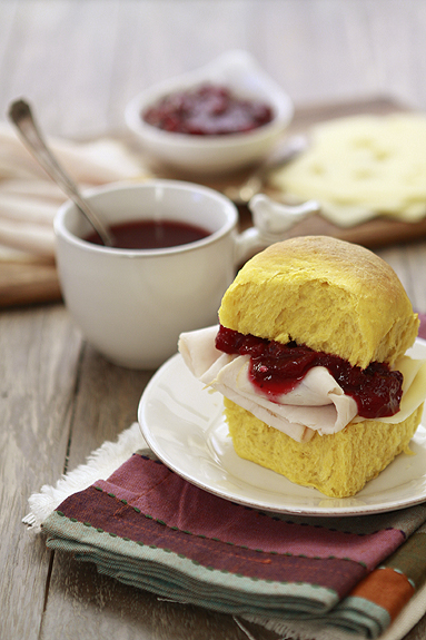 A Thanksgiving turkey sandwich with cranberry sauce.