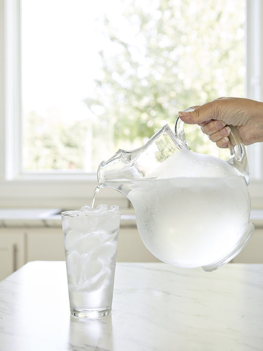pitcher of water pouring into a glass