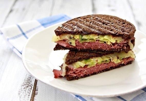 This Reuben Panini is a great way to use up leftover St. Patrick's Day corned beef. It features roasted cabbage, Swiss cheese, and corned beef.