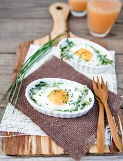 Eggs Baked in White Ramekins with Arugula
