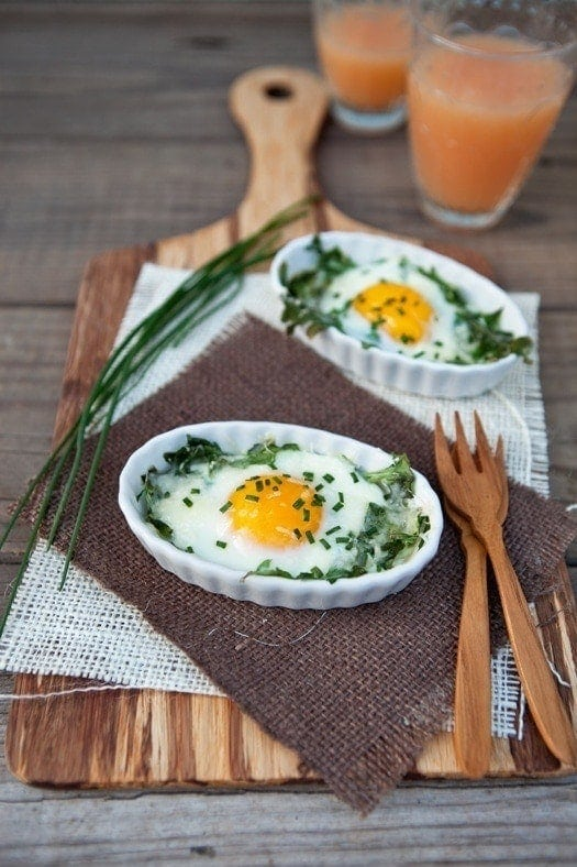 These particular eggs are baked in a bed of fresh arugula with a bit of olive oil to soften it. Topped with parmesan and fresh chives