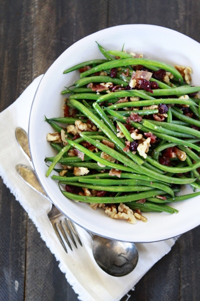 sauteed garlic and bacon green bean recipe with cranberries and walnuts