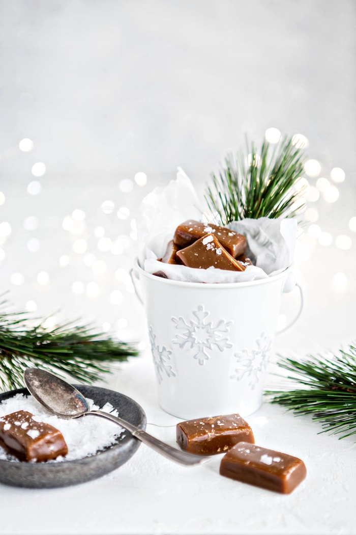 homemade caramels with sea salt next to pine branches