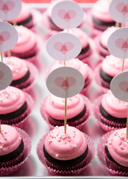 frosted valentine's cay cupcakes with cupcake toppers