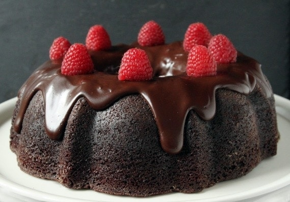 Whole Wheat Chocolate Raspberry Cheesecake Bundt Cake   An extremely moist 100% whole wheat chocolate bundt cake with a tunnel of raspberry cream cheese filling and a healthier chocolate ganache.