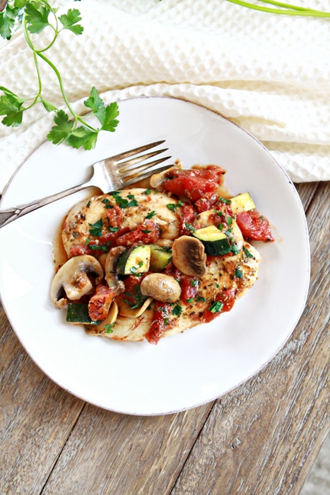 Italian Chicken, Mushroom, and Zucchini Skillet is a super easy dinner recipe for busy school nights. It features pan seared chicken tenderloins, zucchini and sliced mushrooms in garlicky herbed tomato sauce.