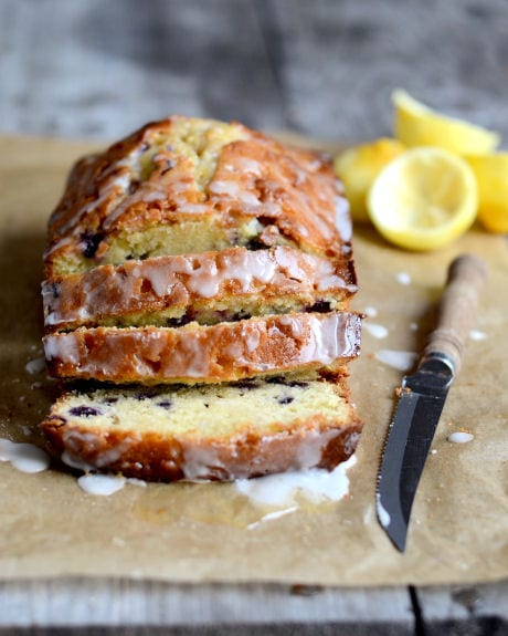 This lemon blueberry bread is studded with juicy blueberries and topped with a simple lemon drizzle. This is such a simple quick bread recipe! #quickbread #lemon #blueberry #breadrecipe #bread