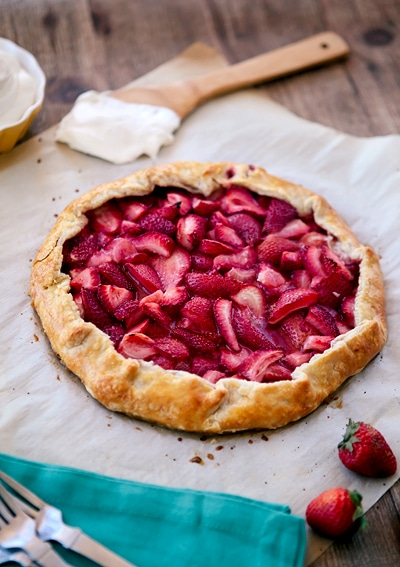 a whole strawberry galette (free form pie) on parchment paper