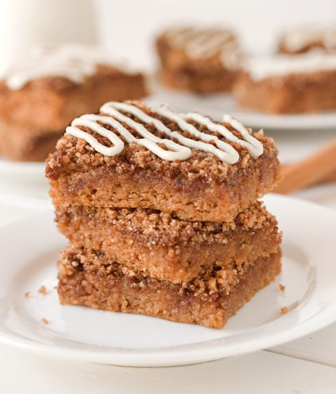 three pieces of gluten free coffee cake stacked on a white plate