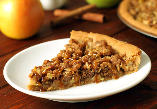 A slice of Apple Crisp Pizza on a white plate