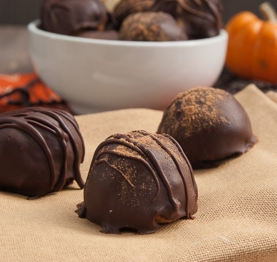 Pumpkin Pie Truffles | Amazingly delicious pumpkin pie turned bite sized into these Pumpkin Pie Truffles, and dipped in delicious dark chocolate!