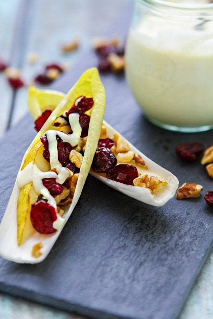 This Endive, Pear, and Walnut Appetizer is perfect for this time of year with the delicious seasonal flavors of pear and cranberry.