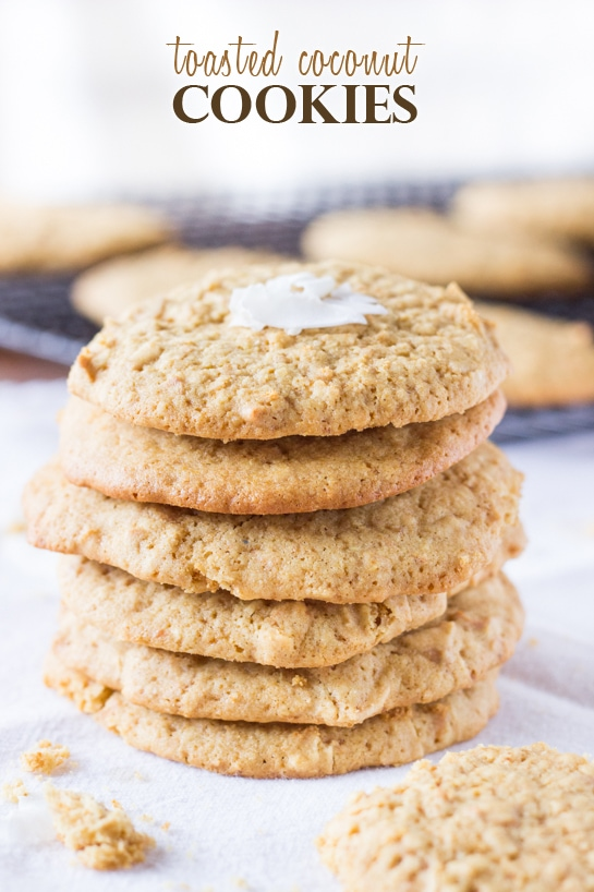 A stack of toasted coconut sugar cookies, garnished with coconut flakes.