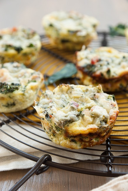 crustless broccoli quiche cups on a wire cooling rack