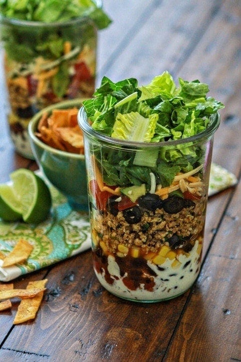 Layered Ground Chicken Taco Salad in a Jar | This layered chicken taco salad in a jar is a great way to experiment with this trend. I love layered salads for their ease of use as well as customization.