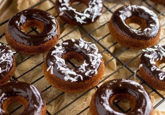 Baked Almond Joy Donuts | Quick and easy donuts that are baked, not fried, and taste like an Almond Joy Candy Bar! They're gluten-free, and much healthier than a traditional donut.