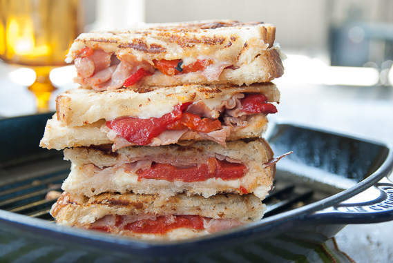 Roasted Red Pepper and Prosciutto Grilled Cheese | A twist on the original grilled cheese using sharp cheddar cheese, Parmigiano Reggiano, roasted red peppers and prosciutto. You won't regret trying this twist!