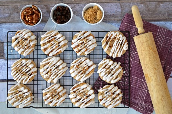 Gluten-Free Cinnamon Roll Cookies | Gluten-free soft cinnamon cookies rolled with a brown sugar, cinnamon, raisin, and pecan filling. Drizzled with a vanilla glaze.