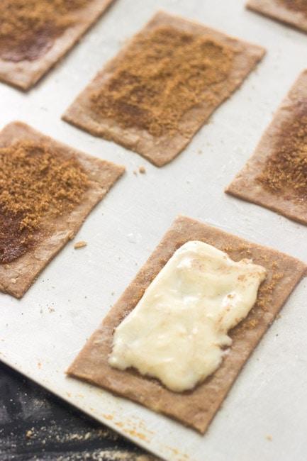 Process shot showing cream cheese brown sugar filling atop pop tart dough