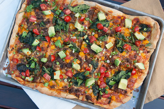 Taco Pizza | A baked pizza version of your favorite food type. Mexican food mashed with pizza. You won't regret this dinner!