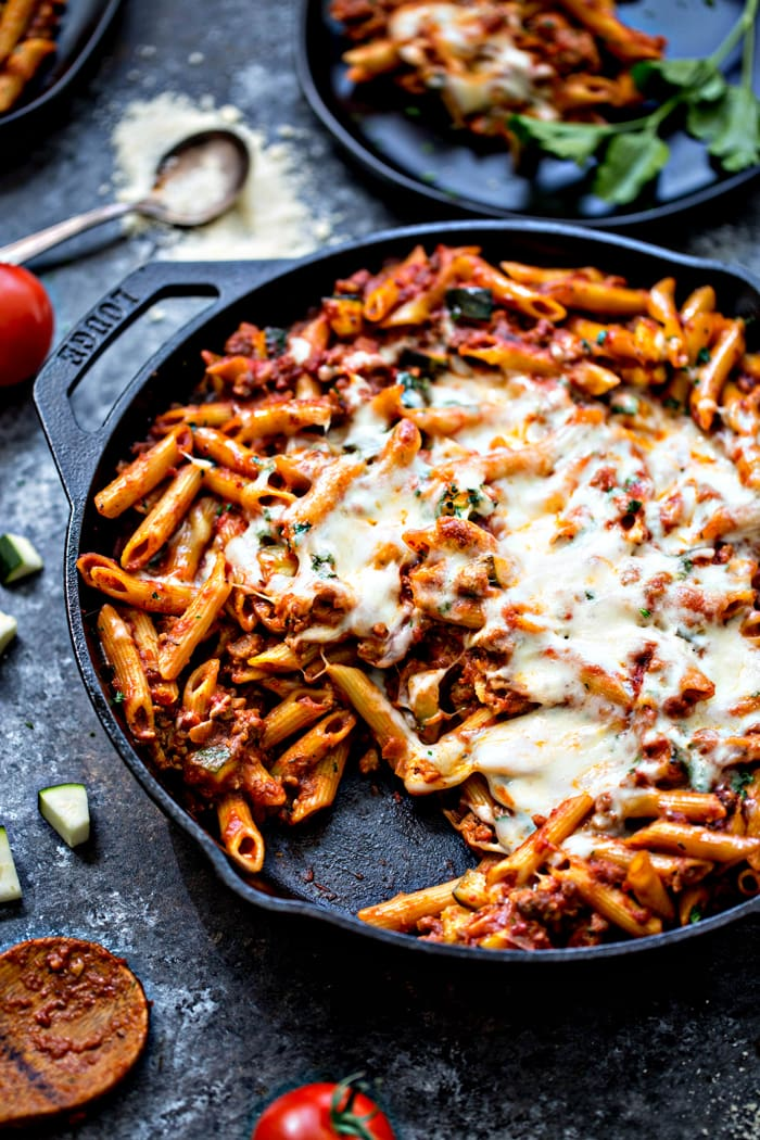 baked ziti with meat sauce in cast iron skillet