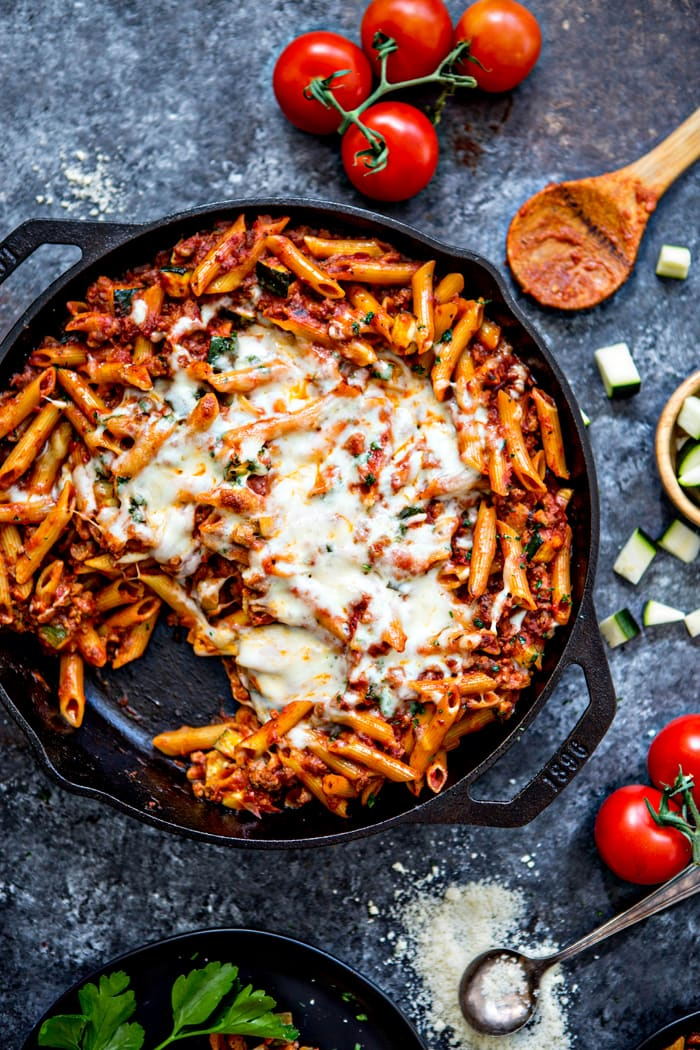 overhead shot of a cast iron skillet with baked ziti