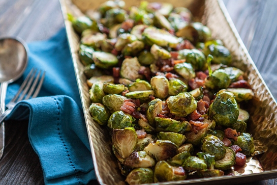 oven roasted brussels sprouts with bacon in serving dish