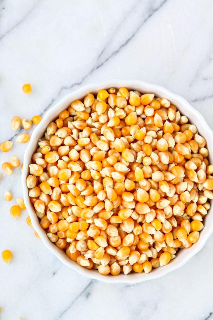 popcorn kernels in white bowl