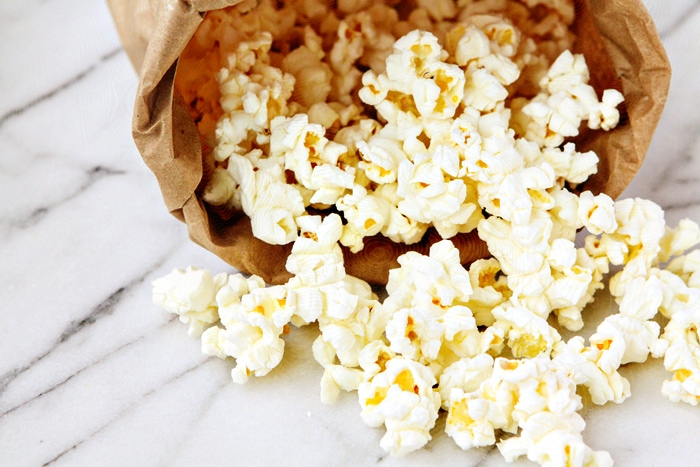 homemade microwave popcorn in brown paper bag