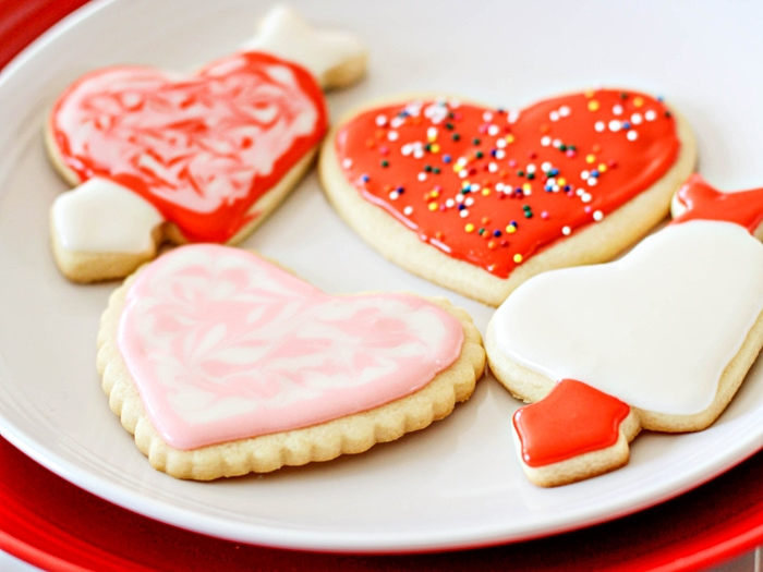 plate of valentine cookies topped with cut-out cookie frosting